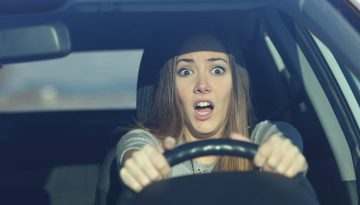 Scared driver driving a car before an accident